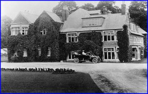 Wroughton Hall 1912 - showing off the new automobile
