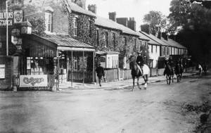 Racehorses passing Kerr's corner shop